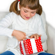 Happy little girl opening a present — Stock Photo #13734705