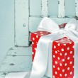 Red gift box with white bow — Stock Photo #13734727
