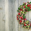 Rustic Xmas wreath on a wooden background — Stock Photo