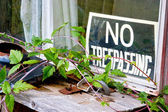 No trespassing sign at window — Stock Photo