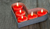Red burning candles on a tray — Stock Photo