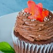 Chocolate cupcake with an orange leaf — Stock Photo
