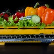 Vegetables on an old yellow kitchen scale — Stock Photo