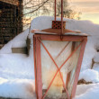 Rustic lantern in snow — Stock Photo