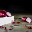 Red onions on a pile of tissues — Stock Photo
