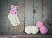 White and pink woolen socks in vintage setting — Stock Photo