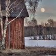 Old red barn in wintry landscape — Stock Photo