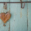 Rusty old heart on wooden background — Stock Photo