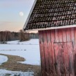Old red barn in snowy landscape — Stock Photo