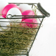 Shopping basket with easter eggs — Stockfoto