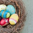 Foto Stock: Painted decorative easter eggs on wooden background
