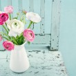 White and pink flowers on light blue chair — Stock Photo #19225257