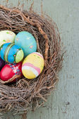 Painted decorative easter eggs on wooden background — Stok fotoğraf