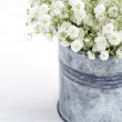 Bouquet of baby's breath flowers, on wooden background — Stock Photo
