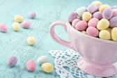 Small easter eggs in a pink cup — Stock Photo