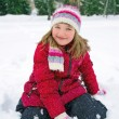 Cute little girl outdoors in winter — Stock Photo