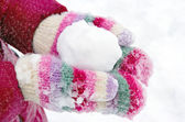 Girl holding a snowball — Stock Photo