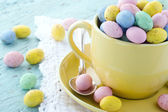 Easter eggs in a yellow cup — Stock Photo
