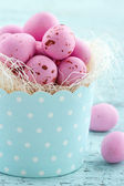 Pink easter eggs in a cupcake cup — Stock Photo