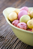 Small easter eggs on a wooden background — Stock Photo