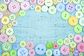 Pastel color buttons on a blue background — Stock Photo