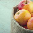 Stock Photo: Apples in basket with vintage editing