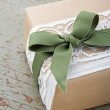 Simple decorative gift box wrapped in brown eco paper and lace — Stock Photo #23241320