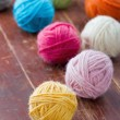 Colorful balls of woolen yarn — Stock Photo