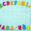 Colorful alphabet letters on light blue background — Stock Photo