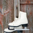 Old figure ice skates on a rustic wooden wall — Stock Photo #23242020