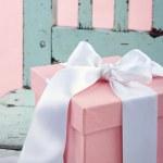 Romantic gift box with white satin bow — Stock Photo