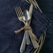 Rustic dinner setting with dark napkin — 图库照片