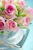 Bouquet of pink roses in a rustic bucket — Stock Photo