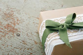 Decorative gift box wrapped in brown eco paper — Stock Photo