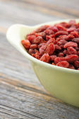 Goji berries in a yellow bowl — Stock Photo