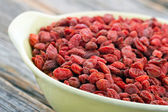 Dried goji berries in a yellow bowl — Stock Photo