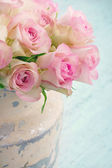 Roses in a shabby chic metal bucket — Stock Photo