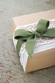 Simple decorative gift box wrapped in brown eco paper and lace — Stock Photo