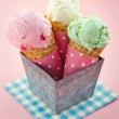 Cones of ice cream on pink vintage background — Stock Photo