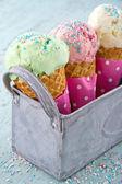 Sprinkles on three ice cream cones — Stock Photo