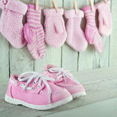 Little girl shoes on green background — Stock Photo