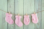 Socks and mittens on vintage clothesline — Stock Photo