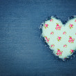 Blue denim jeans with green heart - Stock Photo