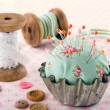 Buttons, pincushion, and other sewing items — Stock Photo