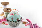 Pincushion in an antique metal cupcake — Stock Photo
