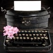 Stock Photo: Old antique black vintage typewriter with flowers