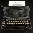 Old antique typewriter with text — 图库照片
