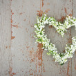 Heart shaped flower wreath of lilys of the valley — Stock Photo