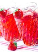 Strawberry juice with frozen icecubes — Stock Photo