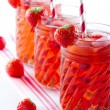 Red strawberry juice with frozen icecubes — Stock Photo #32148195